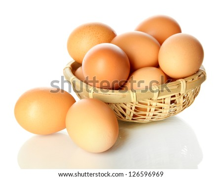 Many eggs in basket isolated on white - stock photo