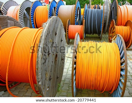 many electricity cables on wooden spools - stock photo