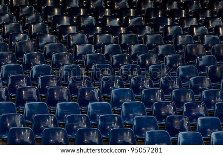 many empty blue sit in stadium