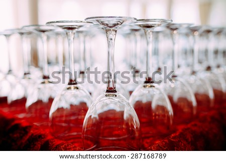Many empty glasses for a wine drying in the bar. Close up photo with selective focus - stock photo