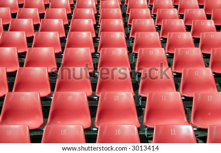 Many Empty Seats In Rows In An Outdoor Stadium