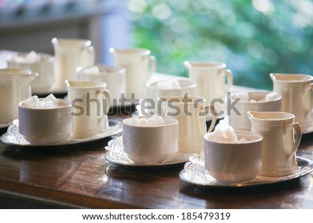 Many empty white cups arranged for a coffee break. - stock photo