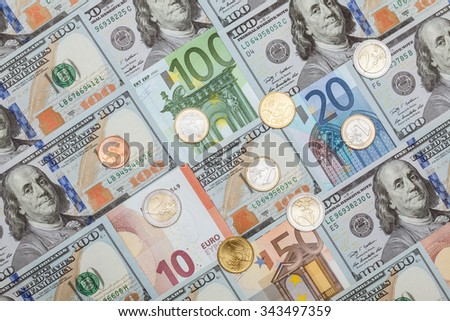 Many euro and dollar banknotes and euro coins- closeup shot - stock photo