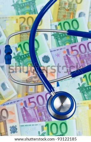 many euro bank notes with a stethoscope. health costs. - stock photo