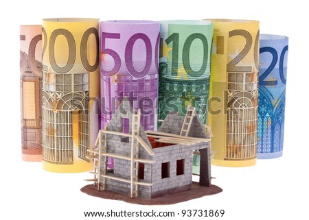 many euro bank notes with shell house. against a white background - stock photo