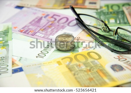 Many euro banknotes and coins