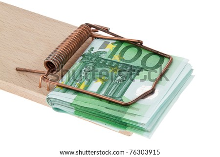 Many Euro banknotes in a mousetrap. Debts and loans - stock photo