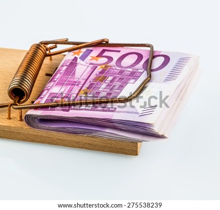 many euro banknotes in a mousetrap. symbolic photo for debt and debt on loans. - stock photo