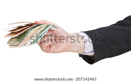 many euro banknotes in businessman hand isolated on white background - stock photo