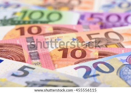 Many Euro banknotes in detail on table