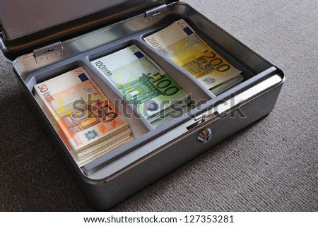 Many 50, 100, 200 Euro banknotes in metal security box - stock photo