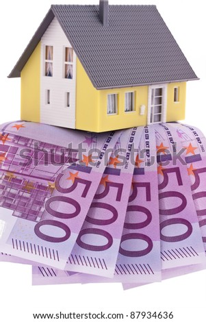 many euro banknotes of the european union. buying a home. - stock photo