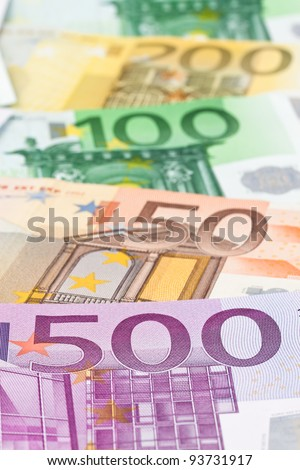 many euro banknotes of the european union. lie side by side