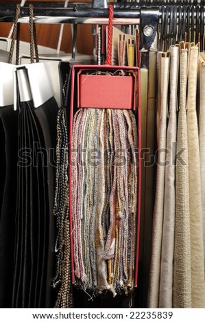 Many examples of upholstery in furniture shop - stock photo