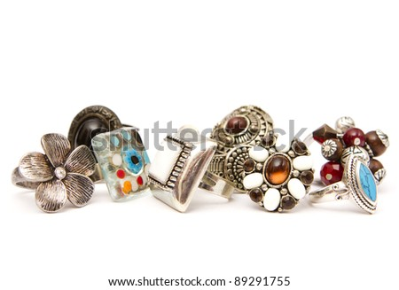 Many fashion silver rings on a white background - stock photo