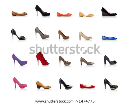 Many fashionable female shoes shot in profile on white background with reflection - stock photo