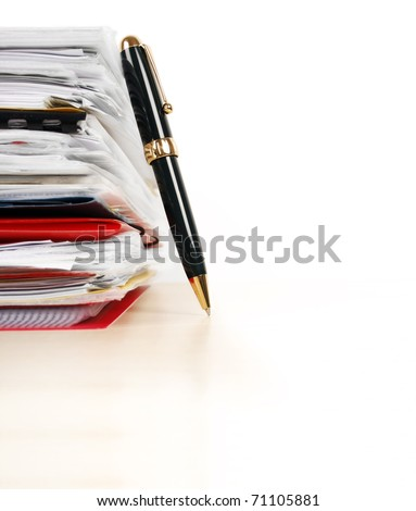 Many files and a pen isolated on white background - stock photo