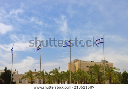 Many flags of Israel  and Jerusalem over blue sky - stock photo