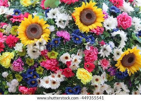 Many flowers with sunflowers and daisies - stock photo