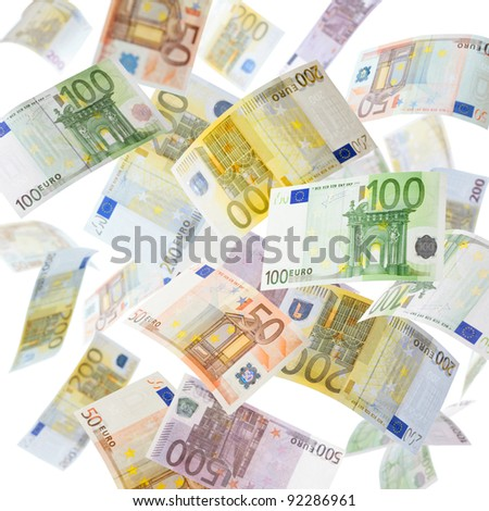 Many flying Euro currency paper money in the air - stock photo