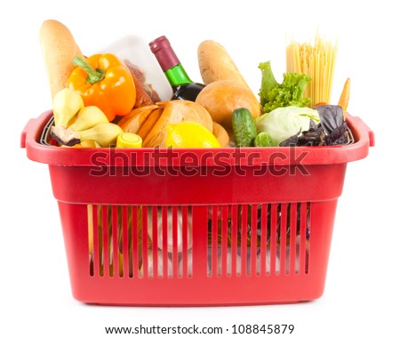 Many food and drinks in shopping basket - stock photo