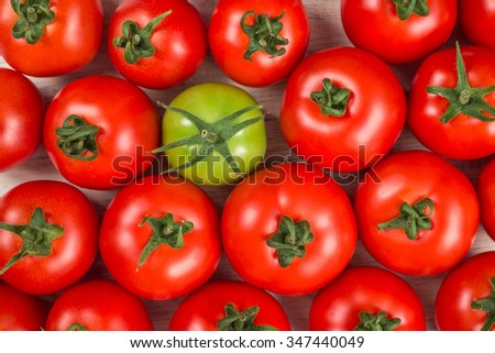 many fresh red tomatoes, one green,  closeup background top view