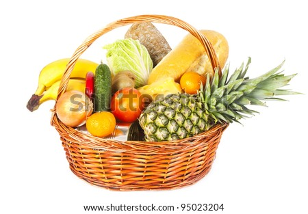 Many fruits and vegetables and other food in basket isolated on white background
