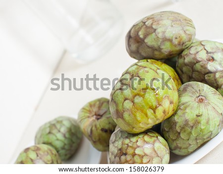 many fruits of cherimoya on table - stock photo