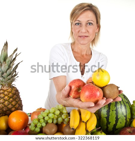 Many fruits stacked together and cute woman