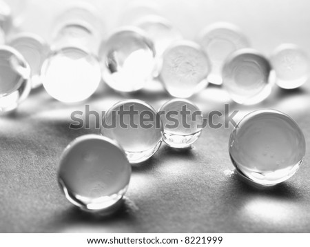 many gel marbles on white background - stock photo
