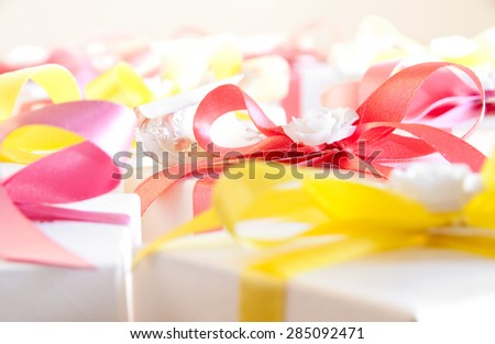 Many gift boxes with a bow - stock photo