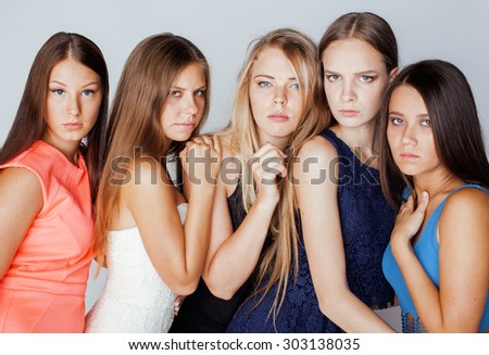 many girlfriends hugging celebration on white background, smiling talking chat - stock photo