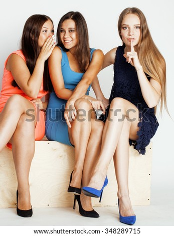many girlfriends hugging celebration on white background, smiling talking chat, girl next door close up wondering. sweety friendship - stock photo