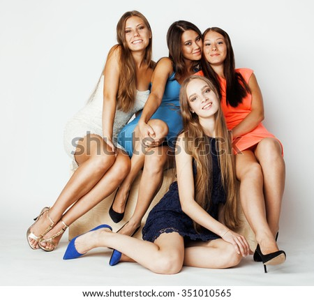 many girlfriends hugging celebration on white background, smiling talking chat, girl next door close up wondering sweety. holiday people - stock photo