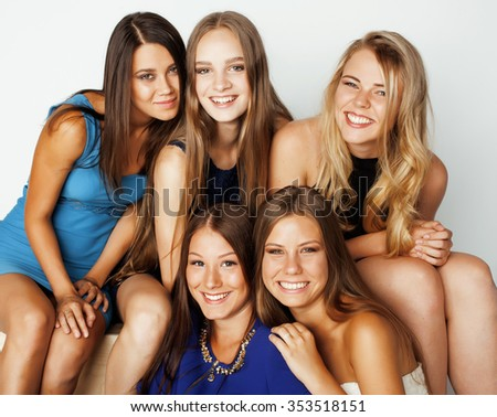 many girlfriends hugging celebration on white background, smiling talking chat, girl next door close up wondering sweety cutie - stock photo