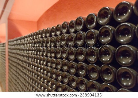 Many glass bottles in winery - stock photo