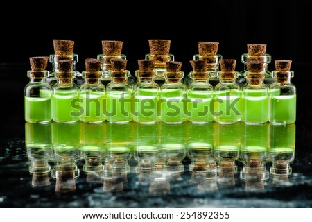 Many glass medicine bottles with color water