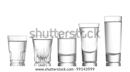 Many glass of vodka isolated on white - stock photo