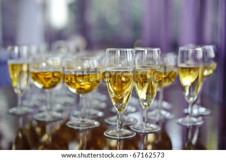 many glasses of champagne with soft focus