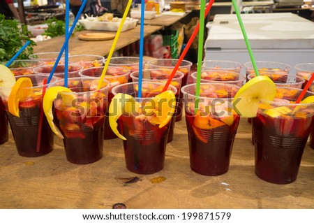 Many glasses with freshly made Spanish sangria - stock photo