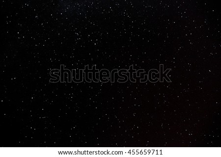 Many glowing colorful stars in the sky at night. - stock photo