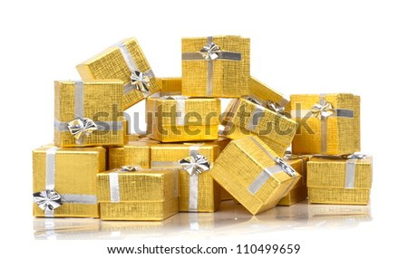 Many gold gifts in a pile on white