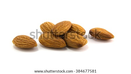many grains are almond isolated on white background - stock photo