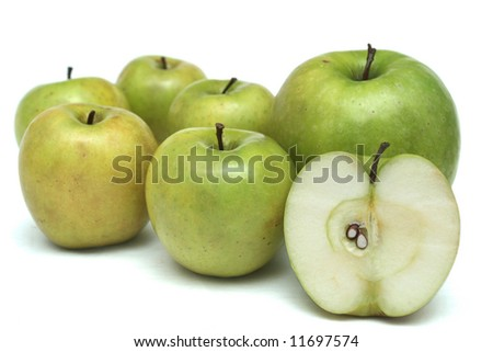 Many green apples on a white background