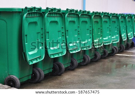 Many green bins arrange out door. - stock photo