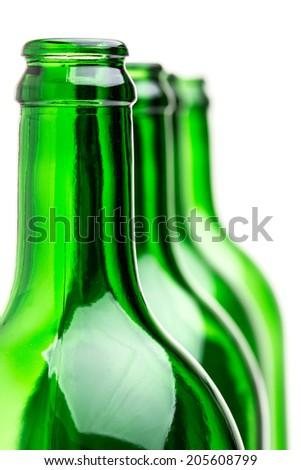 Many green bottles isolated on white background - stock photo