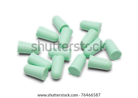 Many green earplugs isolated on white - stock photo
