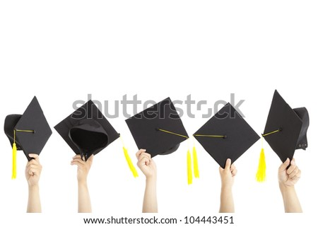 many hand holding graduation hats and isolated on white - stock photo