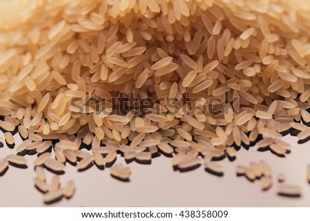 many handful of rice on a dark background. - stock photo