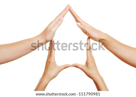 Many hands at home forming a house shape - stock photo